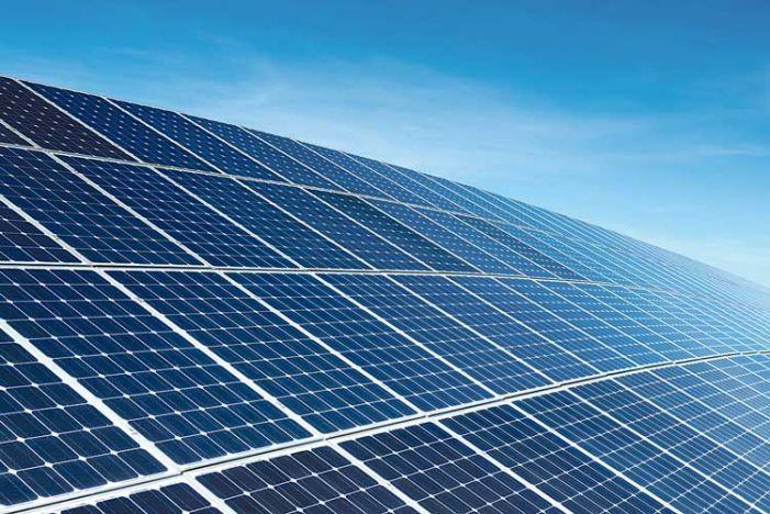 news_stock-art_03-28-18_solar-panel-array-on-building-701x468